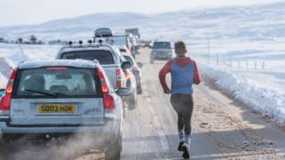 Man running along road at Glencoe