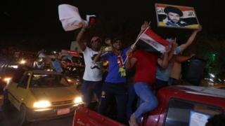 Supporters of Muqtada al-Sadr celebrate in Baghdad, Iraq. Photo: 14 May 2018