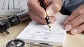 GP writing prescription