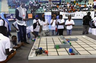 A robot performs during the final of the national robotics competition at the Marius Ndaye stadium in the Senegalese capital Dakar.