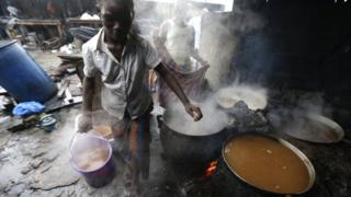 Preparation of African traditional beers brewed with sorghum malt in Koumassi, part of Abidjan, Ivory Coast,
