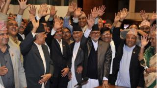 Nepalese prime minister Sushil Koirala (3R),Unified Marxist Leninist chairman K P Oli (4R), Nepalese Unified Communist Party of Nepal (Maoist) chairman Pushpa Kamal Dahal, known better as Prachanda (4L) and other lawmakers celebrate the vote in Kathmandu (16 Sept 2015)