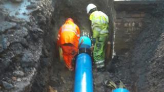Engineers repairing the pipe