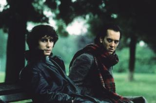 Paul McGann (left) and Richard E Grant on a park bench in the film Withnail and I
