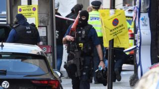 Armed police return to their vehicles following an attack near London Bridge station, 4 June 2017