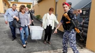 Government election officials carry ballot boxes which will be located in polling stations ahead of the country's May 6 parliamentary election, in Beirut, Lebanon, May 5, 2018.