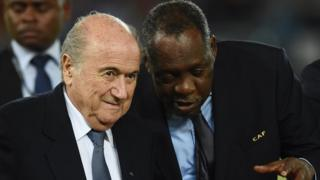 FIFA president Sepp Blatter listens to Confederation of African Football president Issa Hayatou (R) during the 2015 African Cup of Nations final football match between Ivory Coast and Ghana in Bata on 8 February 2015.