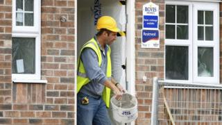 A worker at a Bovis home