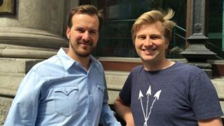 Taavet Hinrikus and Kristo Kaarmann standing outside a bank