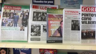 Papurau bro for sale in a Caernarfon newsagents