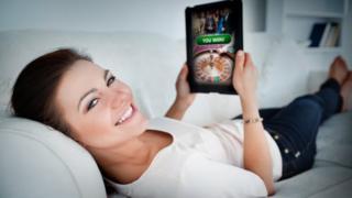 woman gambling on tablet