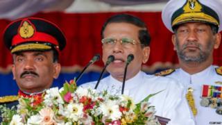 Sri Lankan President Maithripala Sirisena (C) speaks during a Victory Day parade in Matara.