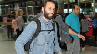 French photographer Mathias Depardon walks at the international departure terminal of Ataturk airport in Istanbul