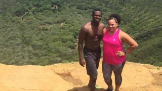 Keenan and Jazzy Owens standing on a hill overlooking trees