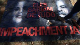 "Poster showing President Dilma Rousseff and former President Luiz Inacio Lula da Silva, with phrase in Portuguese ""They knew everything. Impeachment Now"". 14 April 2016"