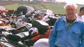 Eric Winn with motorcycles
