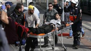 Wounded Israeli guard wheeled on a stretcher (10/11/15)
