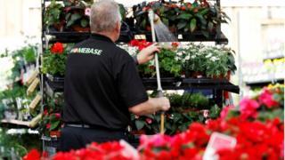 Homebase worker watering flowers