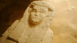 An undated handout photo made available by Egyptian Ministry of Antiquities shows a sarcophagus that was discovered in ancient tombs in Minya governorate, Egypt (issued 15 August 2017). According to the Egyptian Ministry of Antiquities, an excavation mission working at Al-Kamin Al-Sahrawi area of Minya governorate discovered three Ptolemaic tombs and unearthed a collection of sarcophagi of different shapes and sizes as well as clay fragments that date the tombs between the 27th Dynasty and the Greaco-Roman era.