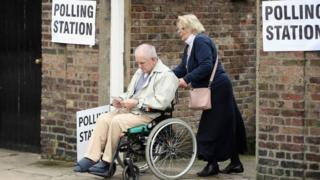 Wheelchair user visits a polling station