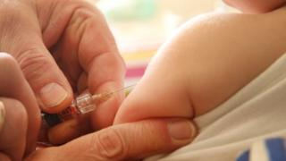Vaccine and syringe - file pic