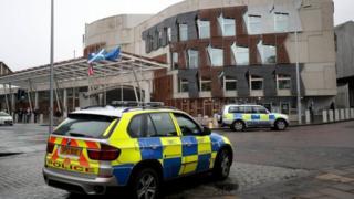 Police cars outside Holyrood