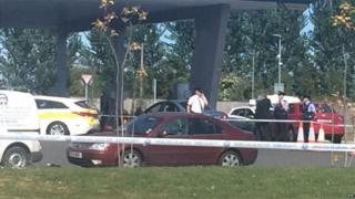 Car with crime scene tape