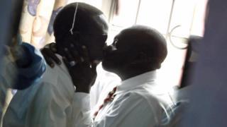 Gay men kiss in Kenya