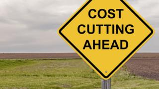Sign warning of cost cutting