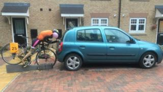 Cycling scarecrow