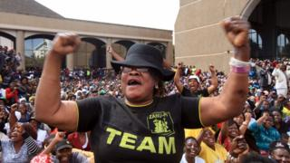 Zimbabwean supporter of President Robert Mugabe in Harare, Zimbabwe