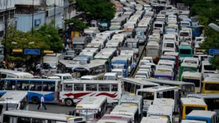 Drivers block a main avenue in Caracas during a protest due to the shortage of spare parts for their vehicles on 21 September
