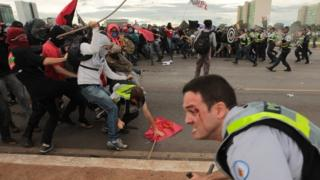 Protesters clash with police outside the National Congress building