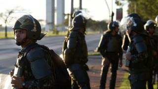 Brazilian Army military police in riot gear guard public buildings in Brasilia, on May 25, 2017