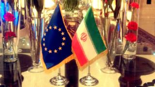 The EU and Iranian flags displayed in Tehran