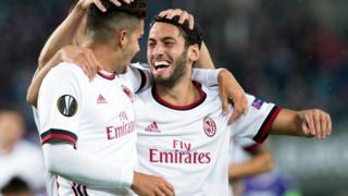 AC Milan forward Andre Silva (L) dey celebrate as im score with midfielder from Turkey Hakan Calhanoglu