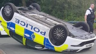 Police car on its roof
