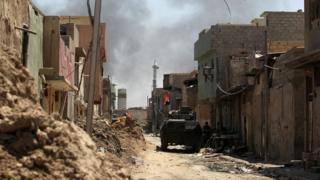 Smoke billows as Iraqi forces advance towards the Old City of Mosul on 19 June 2017