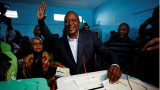 Kenyan President Uhuru Kenyatta casts his ballot inside a polling station in his hometown of Gatundu in Kiambu county, Kenya August 8, 2017