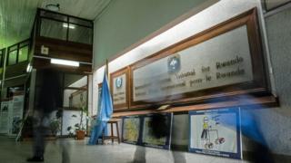 People walk inside the International Criminal Tribunal for Rwanda (ICTR) in Arusha