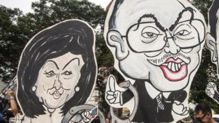 A caricature of Malaysian Prime Minister Najib Razak and his wife