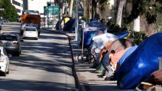 Tents from a homeless encampment line a street in downtown Los Angeles on 26 January 2016