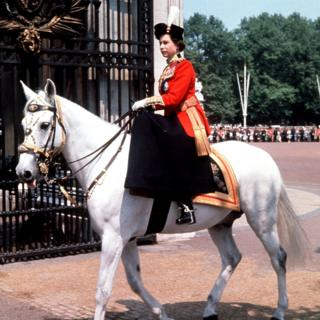 Riding side-saddle, the Queen returns to Buckingham Palace