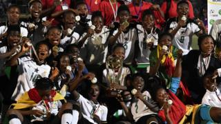 "Ghana team players celebrate with trophy after winning the first West African Football Union (UFOA) zone B women""s tournament final match between Ghana and Ivory Coast at the Parcs des Sports in Abidjan on February 24, 2018"