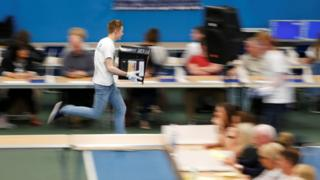 A ballot box is rushed into the counting centre for Britain's general election in Sunderland, 8 June 2017.