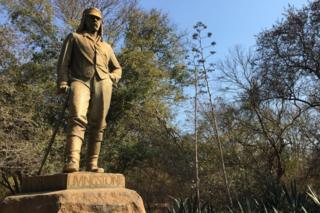 The statue of David Livingstone next to the Victoria Falls