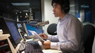 oice Of America (VOA) Afghan Service broadcaster Daoud Sediqi listens to a caller during a show on September 16, 2009 in a studio of the VOA in Washington.