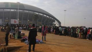 people queue to get into the Bingu stadium