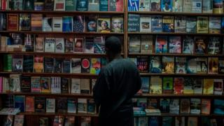 Kunle Tejuoso, owner of The Jazz Hole organizes bookshelves on January 30, 2018. The Jazz Hole is an independent record and book store in Lagos.