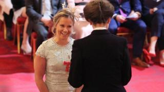 Sailor Hannah Mills being awarded her MBE
